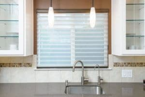 This Silhouette Window Shading offers light control, privacy and a beautiful soft look at this kitchen window.